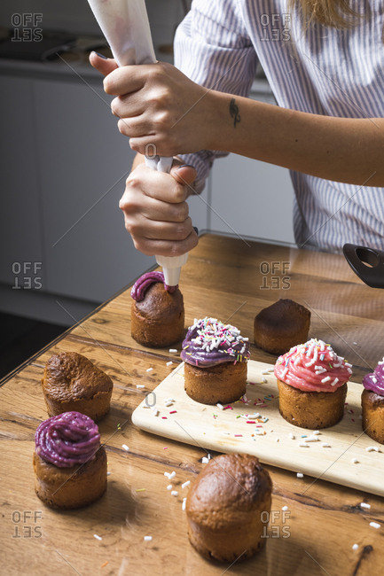 Woman preparing muffins at home
