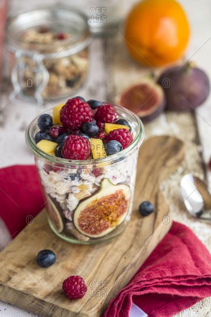 Glass of natural yogurt with granola and various fruits
