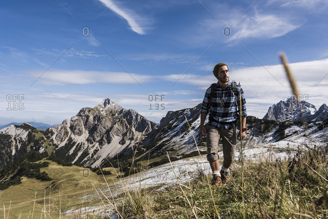 Austria- Tyrol- young man hiking in the mountains