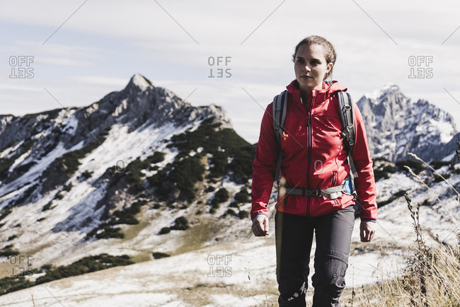 Austria- Tyrol- young woman hiking in the mountains