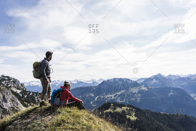 Austria- Tyrol- young couple in mountainscape looking at view