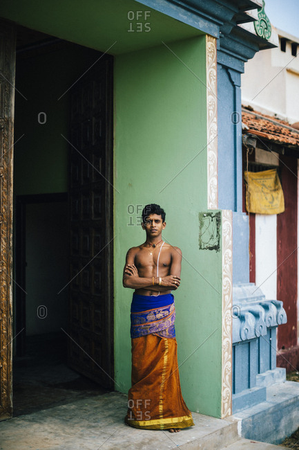 Jaffna, Sri Lanka - February 8, 2018: Portrait of young Hindu caretaker at entrance to the Kannakai Amman Temple on Punkudutivu island off the Jaffna Peninsula