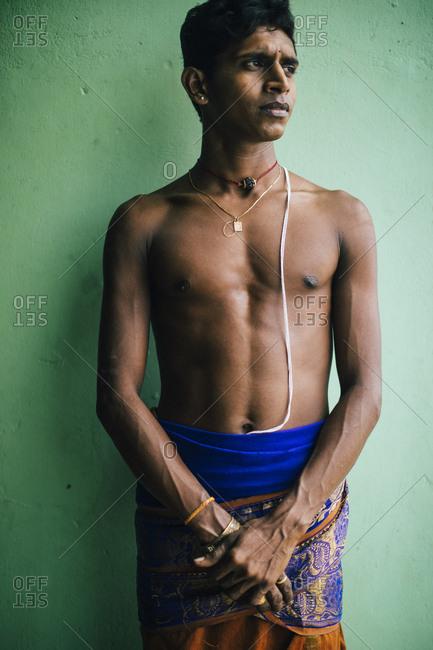 Jaffna, Sri Lanka - February 8, 2018: Portrait of young Hindu caretaker at the Kannakai Amman Temple on Punkudutivu island off the Jaffna Peninsula