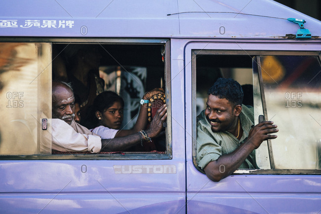 Jaffna, Sri Lanka - February 9, 2018: Driver and passengers waiting for mini bus to fill up at the central market and bus station in downtown Jaffna