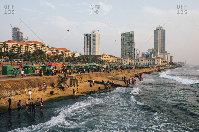 Colombo, Sri Lanka - February 10, 2018: People enjoying the sunset and the sea at Galle Face Green