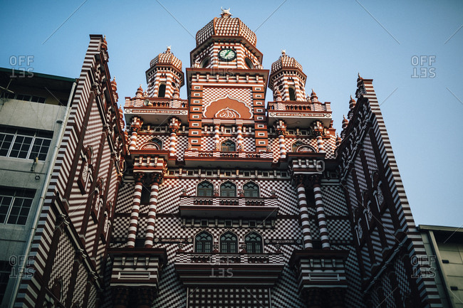 Colombo, Sri Lanka - February 11, 2018: Looking up at the distinctive facade of the Red Mosque