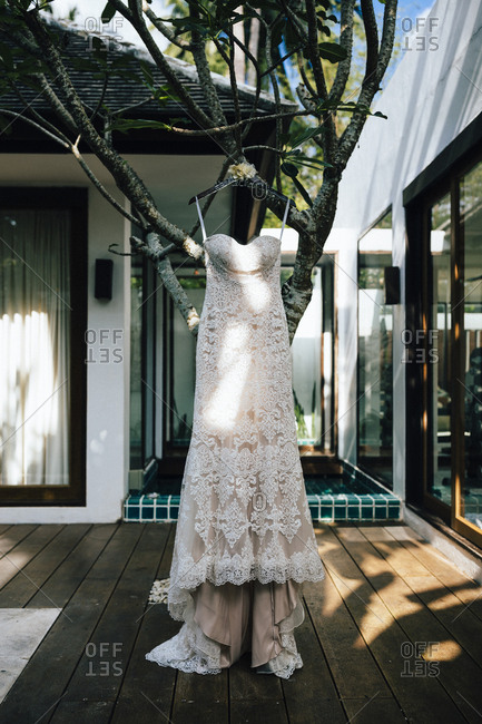 Ko Samui, Thailand - December 11, 2017: Wedding dress hanging from a tree at a beachside villa