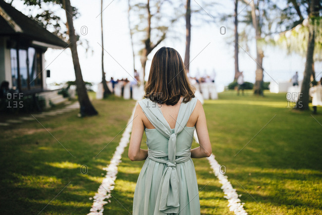 Ko Samui, Thailand - December 11, 2017: Bridesmaid walking down the aisle at an afternoon beachside wedding