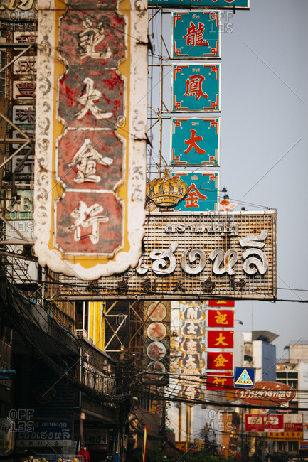 Bangkok, Thailand - January 23, 2018: Old signs lining the roads of Chinatown in the early morning