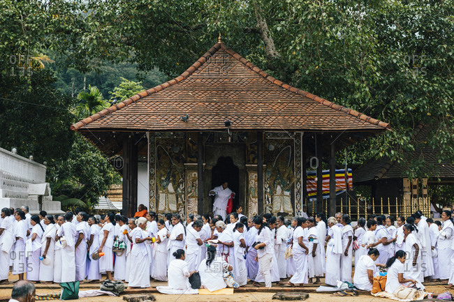Kandy, Sri Lanka - January 31, 2018: Crowds gather outside the Temple of the Tooth for free breakfast on Poya Day