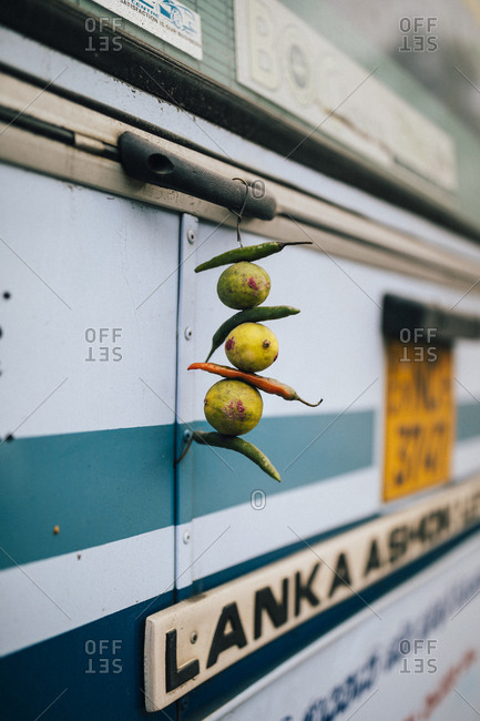 Kandy, Sri Lanka - January 31, 2018: Chilis and limes hang from the back of a bus
