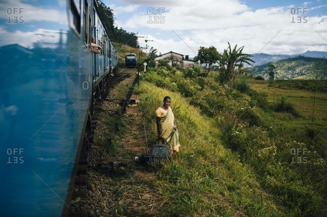 Ella, Sri Lanka - February 1, 2018: A train driving around bend in tea plantation  countryside