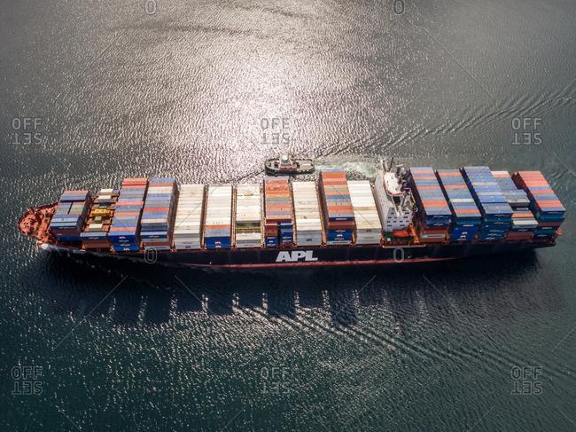 April 29, 2017:Aerial view of a shipping boat in Unalaska bay, USA