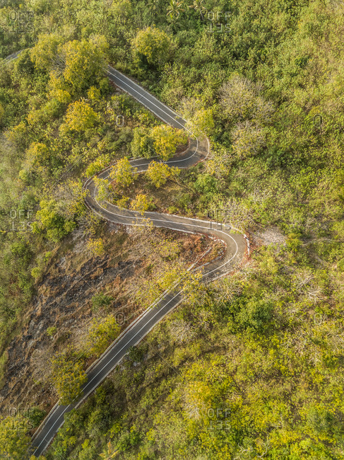 Aerial view of a serpentine empty road in Nusa penida, Bali, Indonesia.