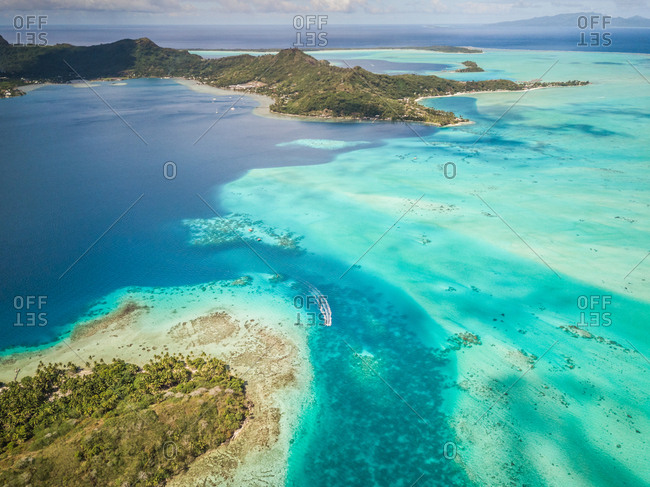 Aerial view of a boat in the reef in Bora-Bora, French Polynesia.