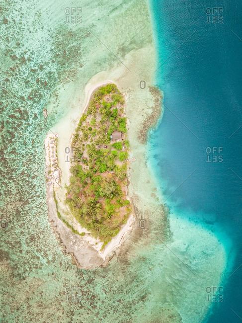 Aerial view of small island Motu Aki  in French Polynesia.