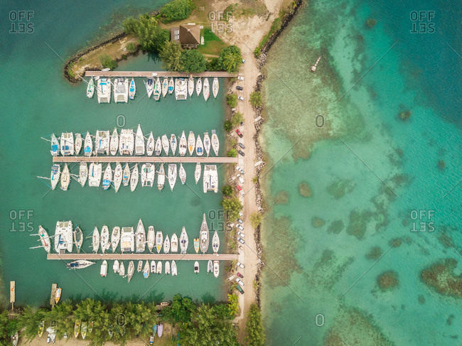 Aerial view of a small harbor in Vai'are on Moorea island in French Polynesia.