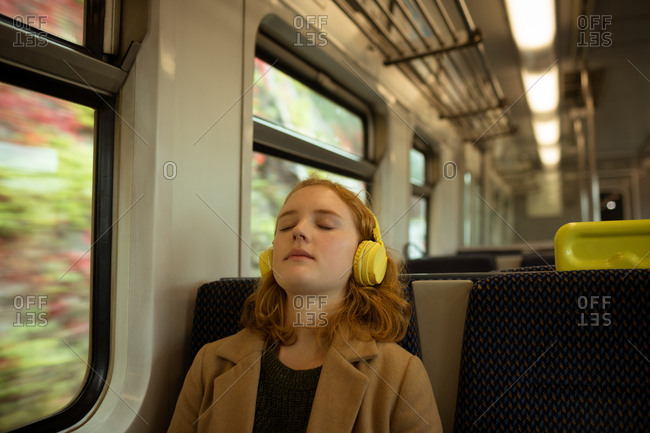 Young woman relaxing while listing to music