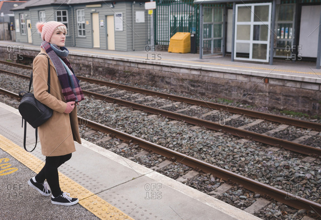 Woman waiting for train in railway station
