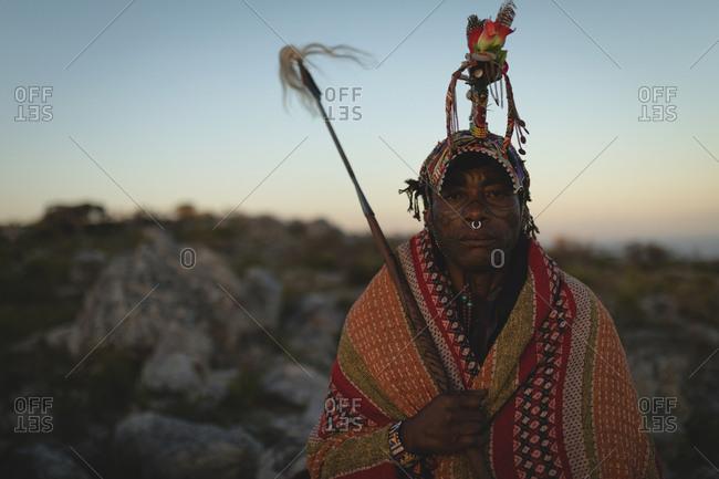 Maasai man standing at countryside