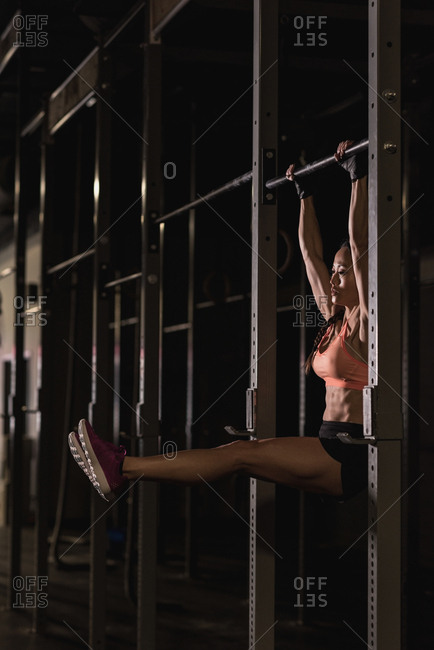 Fit woman doing pull-up