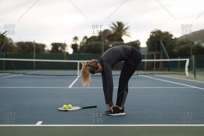 Woman exercising in tennis court