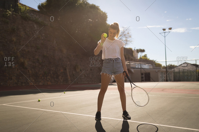 Woman practicing tennis in the tennis court