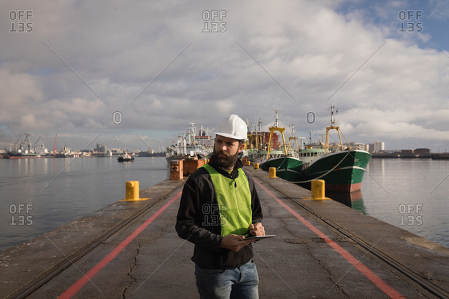 Dock worker using digital tablet