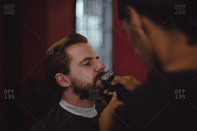 Man getting his beard trimmed with trimmer