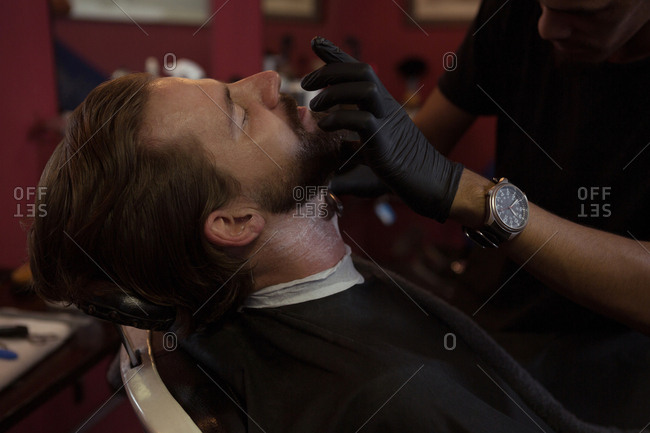 Man getting his beard shaved with trimmer