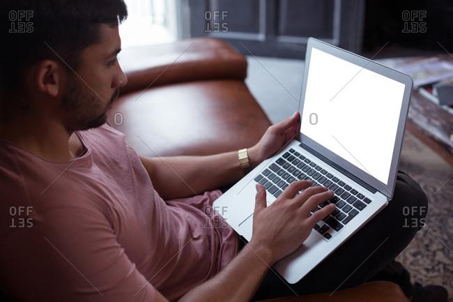 Male customer using laptop