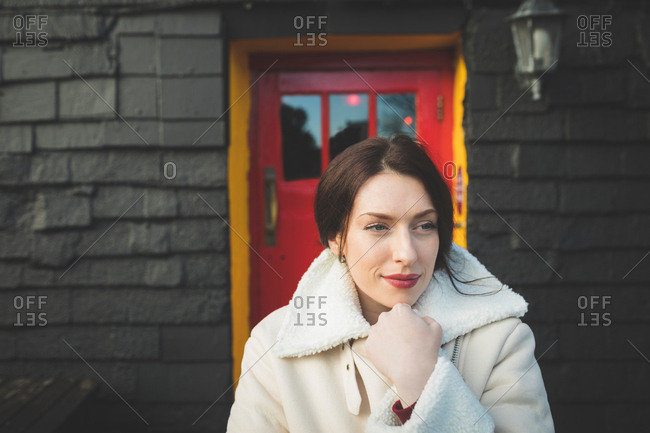 Woman standing in front of house