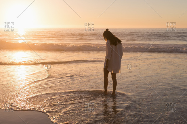 Woman standing in sea on the beach