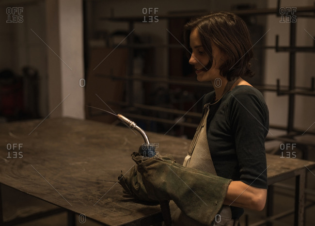 Female welder holding welding torch