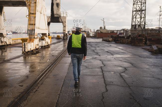 Dock worker walking in the shipyard