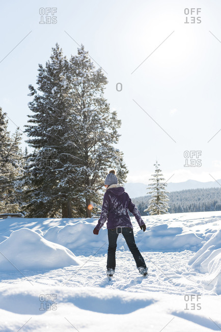 Woman skating in snowy landscape