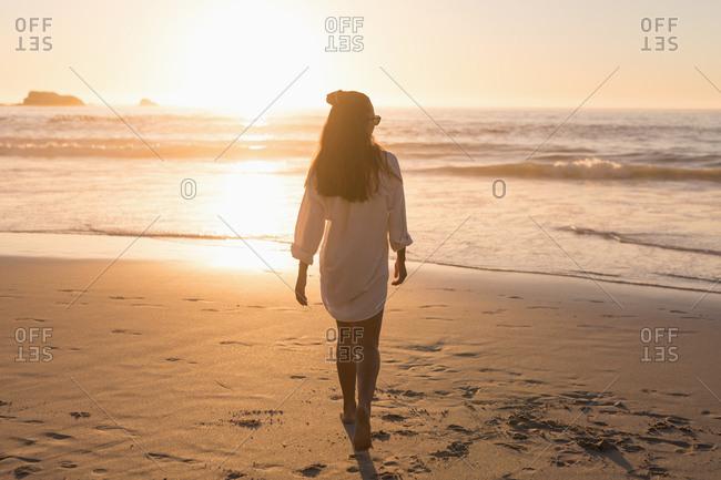 Woman walking in the beach