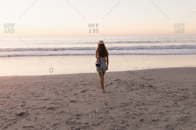 Woman holding vintage camera in the beach