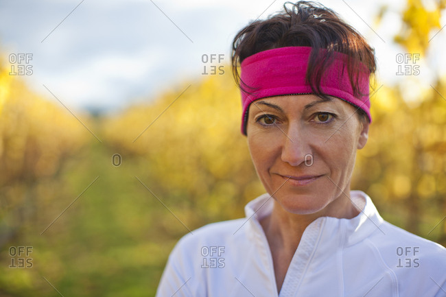 Portrait of a mid adult woman wearing a pink sweat band on her head