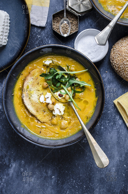 Carrot and pumpkin soup with crispy chikpeas and ricotta