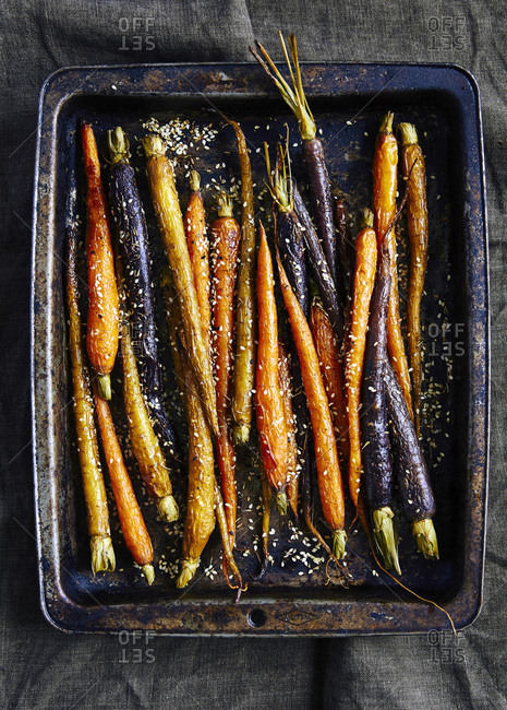 Roasted heirloom carrots on baking tray, with zaatar after baking