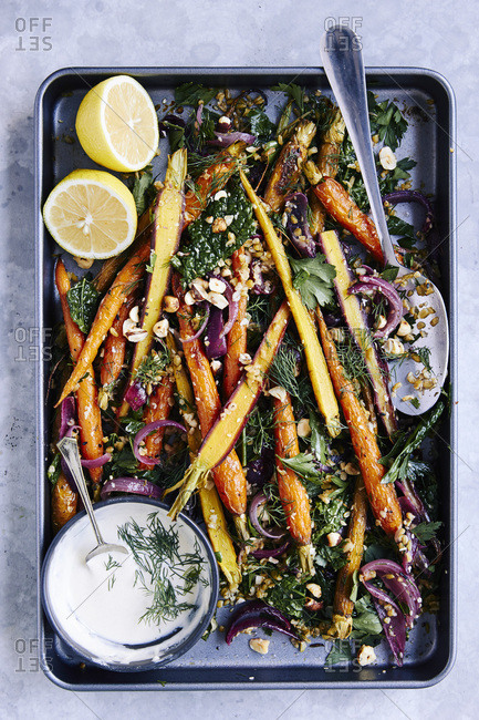Roasted heirloom carrots, cooked freekeh grain, roasted red onions, kale, parsley, dill, maple syrup and orange dressing with zaatar