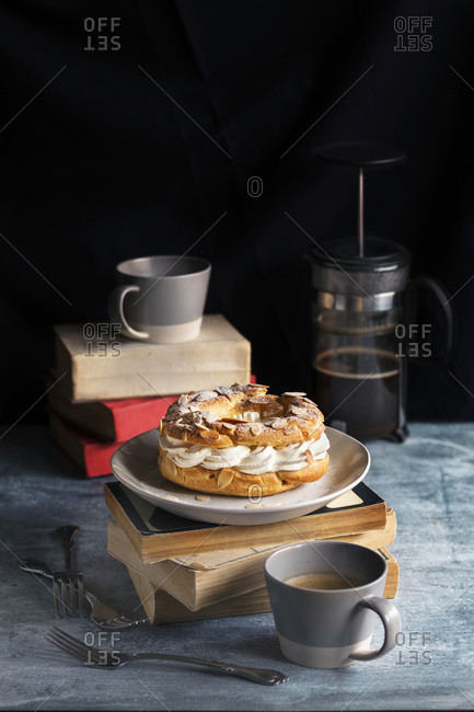 French pastry, coffee mugs and French coffee pot on the table