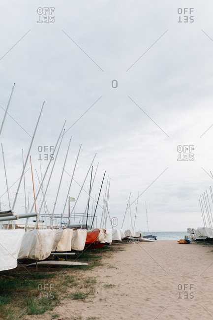 Covered sailboats being stored on the coast of Spain