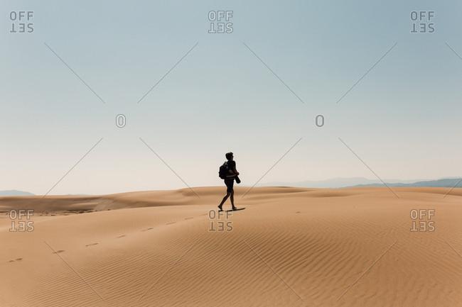 Man walking in the Platja del Fangar, Deltebre, Tarragona, Spain
