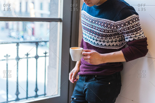 Ethnic young man drinking coffee