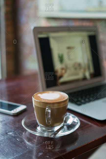 Coffee and device on table