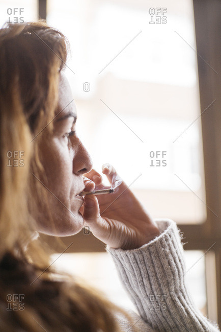 Woman relaxing and smoking