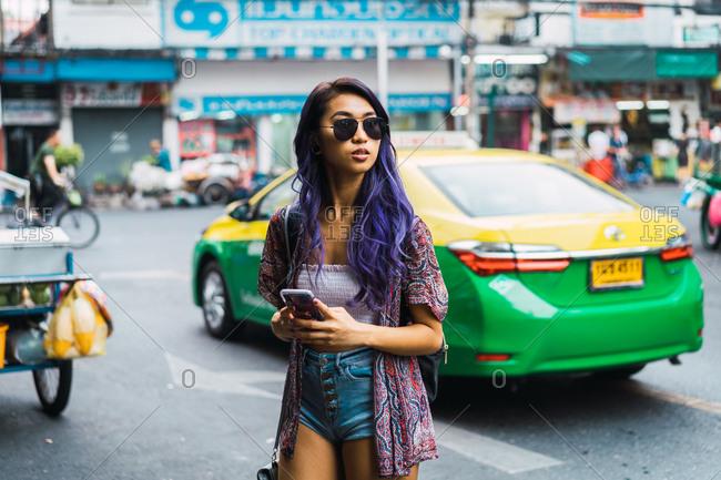 Pretty Asian woman on street