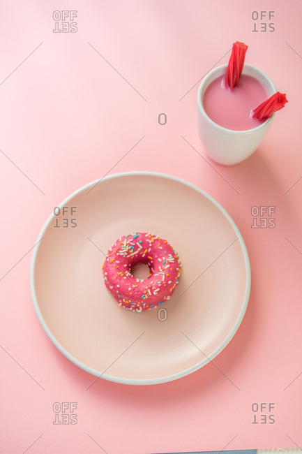 Sweet pink doughnut and sweet pink drink with jelly candies
